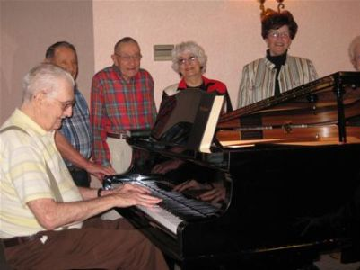 EM Residents Around Piano
