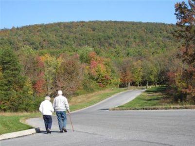 Mountain Shot With Walking Couple